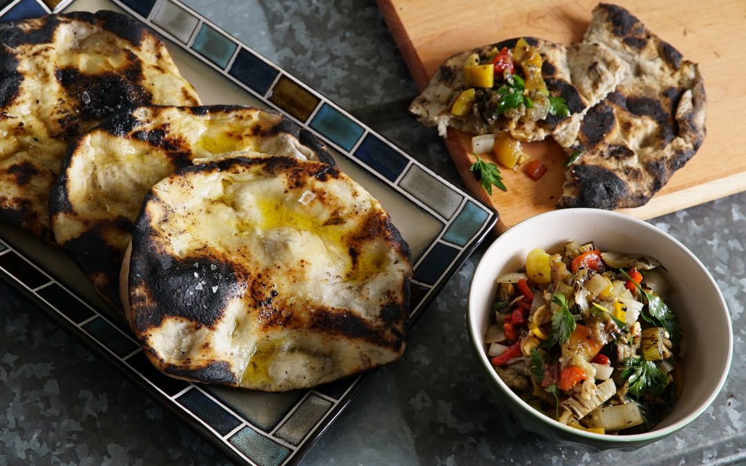FLATBREAD GRILLED IN THE EMBERS WITH ESCALIVADA
